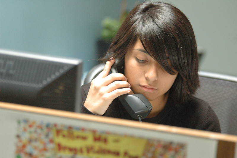 Photo: Excelsior/ -7/29/08- Karen Salinas, 18, of Santa Ana, sits at the front desk and is the first person to speak to any visitors or callers at the Orange County Bar Foundation as part of her participation with the Project SELF (Summer Employment with Law Firms) Legal Internship Program. Photo Courtesy of the Orange County Chapter of the Association of Legal Administrators and the Orange County Bar Foundation.