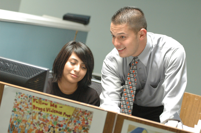 Photo: Excelsior/ -7/29/08- Karen Salinas, 18, of Santa Ana, researches with Program Coordinator Robert Diaz for Shortstop, a juvenile diversion program at the Orange County Bar Foundation in Santa Ana, July 29, 2008. Salinas is participating in Project SELF (Summer Employment with Law Firms) Legal Internship Program. Photo Courtesy of the Orange County Chapter of the Association of Legal Administrators and the Orange County Bar Foundation.