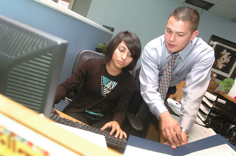 Photo: Excelsior/ -7/29/08- Karen Salinas, 18, of Santa Ana, researches the cell phone law for minors with Program Coordinator Robert Diaz for Shortstop, a juvenile diversion program at the Orange County Bar Foundation in Santa Ana, July 29, 2008. Salinas is participating in Project SELF (Summer Employment with Law Firms) Legal Internship Program. Photo Courtesy of the Orange County Chapter of the Association of Legal Administrators and the Orange County Bar Foundation.