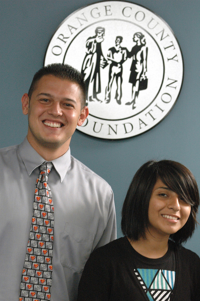 Photo: Excelsior/ -7/29/08- Karen Salinas, 18, of Santa Ana, with Program Coordinator Robert Diaz  work together on projects for Shortstop, a juvenile diversion program at the Orange County Bar Foundation in Santa Ana, July 29, 2008. Salinas is participating in Project SELF (Summer Employment with Law Firms) Legal Internship Program. Photo Courtesy of the Orange County Chapter of the Association of Legal Administrators and the Orange County Bar Foundation.