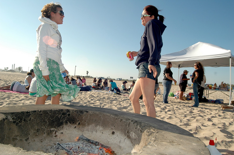 Photo: Jess Block/ -7/11/07-  Judy Padilla, mentor, and Mariela Cadena, OCBF program assistant talk about their world travels by the bonfire. A beach barbeque was held honoring all participants past and present in the Orange County Bar Foundation's Higher Education Mentoring Program Wednesday July 11, 2007. The program targets latina high school students providing culturally relevant support in preparation for college. Photo courtesy of Orange County Bar Foundation