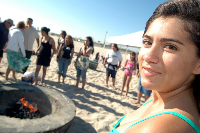 Photo: Jess Block/  -7/11/07- Ruth Gonzales, 17, from Santa Ana, who will be attending UC San Diego in the fall, stands by the fire. A beach barbeque was held honoring all participants past and present in the Orange County Bar Foundation's Higher Education Mentoring Program Wednesday July 11, 2007. The program targets latina high school students providing culturally relevant support in preparation for college. Photo courtesy of Orange County Bar Foundation
