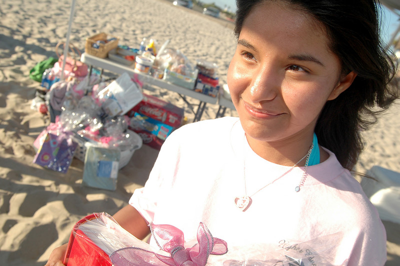 Photo: Jess Block/ -7/11/07-  Lisette Vega, 16, of Santa Ana recieves a raffle prize. All the prizes were tailored for students going to college, including bedsheets, laundry hampers, and photo albums. A beach barbeque was held honoring all participants past and present in the Orange County Bar Foundation's Higher Education Mentoring Program Wednesday July 11, 2007. The program targets latina high school students providing culturally relevant support in preparation for college. Photo courtesy of Orange County Bar Foundation/