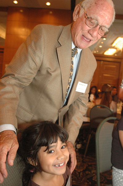 Photo: Jess Block/ Current/ -8/7/08- Cielo Soriano, sister of a projct SELF intern, is greeted by retiring judge Justice John Arguelles, at the Project SELF Recognition Dinner, Wednesday August 6 at the Wyndham Garden Hotel in Costa Mesa. 33 students were recognized for their participation in an 8-week long paid internship in Orange County law firms, a collaborative program with the Orange County Bar Foundation and the Orange County Chapter of the Association of Legal Administrators. Photo by Jess Block/ Current