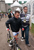 Voeckler is escorted to drug control after his press conference.