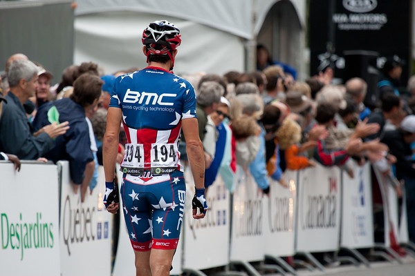 Hincapie waits for a replacement bike after he was unable to ride away after a crash.