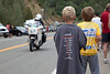 Two young fans await the race near the bottom of the KOM climb