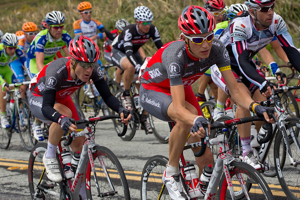 ...till Brajkovic escorts him to the front of the group.