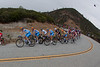 A light rain is now falling as the peloton enters a hairpin turn. (this is a crop from a much wider image)