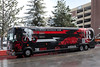 The team RadioShack bus, wrapped in graphics designed by Shepard Fairey sits outside the host hotel. The race start has been delayed a few hours to evaluate the weather.