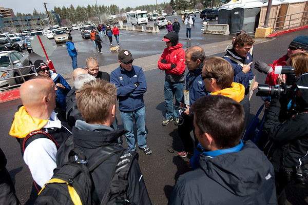 The discussion between team staff and race organziers began under sunny skies...