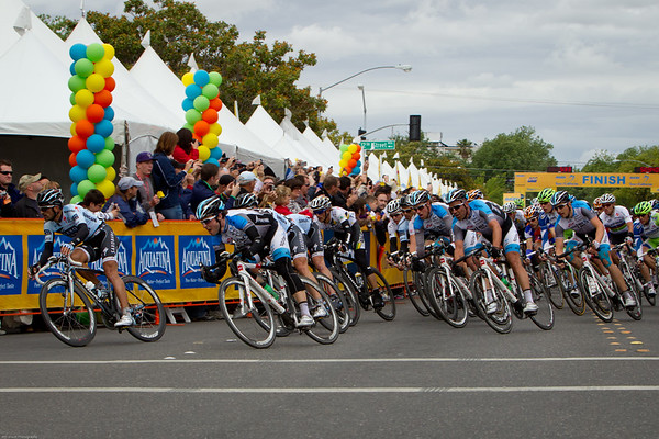 With one lap to go, Saxo, HTC, and Spider Tech are on the front, but the rainbow jersey is moving forward.