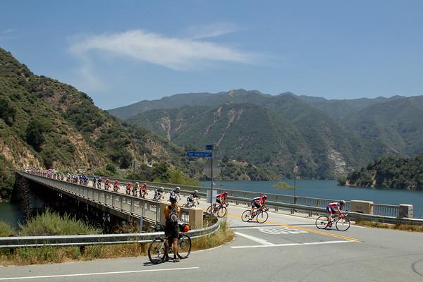 RadioShack leads the peloton across the bridge in chase of the break...