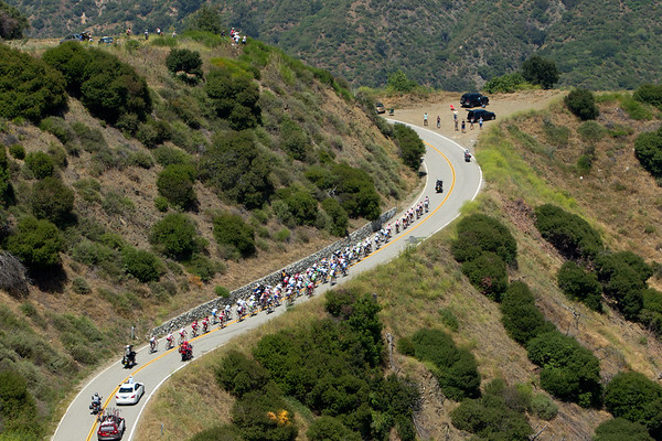 Numbering about 65 now, the peloton nears the top of the first major climb...