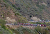 The peloton climbs Balcom Canyon, the break holding around three minutes.