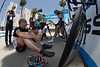 Just after the riders were called to the line for the start, it was learned there was a car crash out on the route. So, with the start delayed; Horner, Van Garderen, Zabriskie and Busche find shade for the wait.