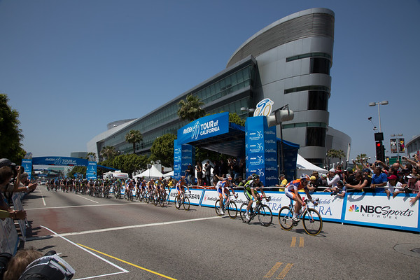 Starting their final lap, the peloton looks composed as a rider or two try a late escape, to no avail...