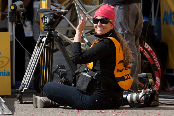 Liz Kreutz, documenting Lance Armstrong's return to cycling, waves from the bottom of the ramp.