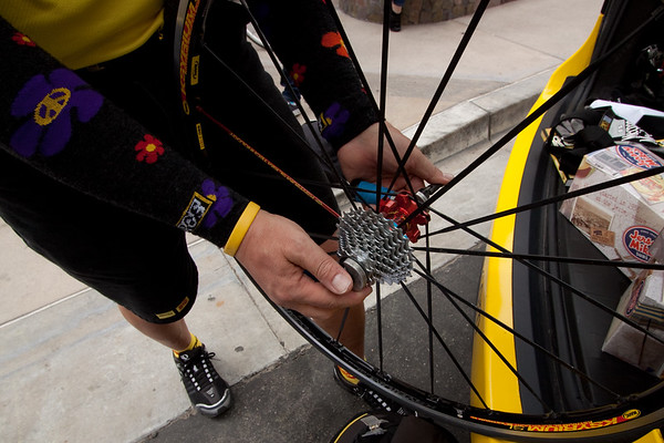 Brian Dallas, of Mavic Neutral Service, uses droputs on short sticks to prep skewer spacing/tightness for the wheels in one of the Mavic neutral support cars.