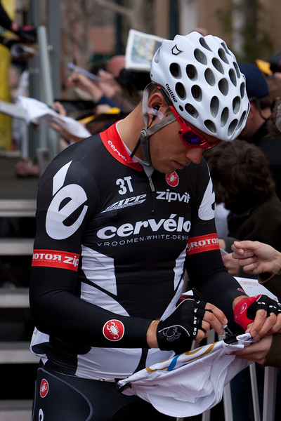 Thor Hushovd signs for a fan at the start of Stage seven in