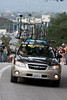 One of the Astana team cars crests the hill beyond the start finish line in stage 7 of the Amgen Tour of California.
