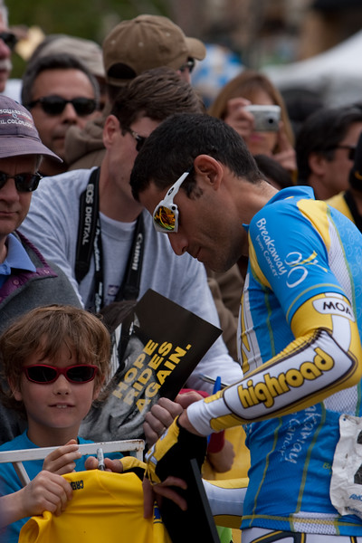 George Hincapie signs for a fan