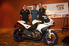 Brad Huff (Jelly Belly Cycling) Mark Cavendish (Columbia-HTC) and Thor Hushovd (Cervelo Test Team) pose with the Buell 1125r which will be given to the winner of stage 1 of the Tour of Missouri.