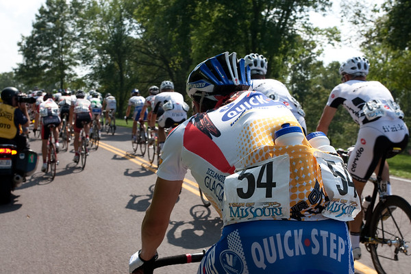 No hand in the back for Malacarne of Quick Step, just a full jersey of bottles. He's the custodian of the Young Rider's jersey, as Cav is in yellow.