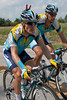 A light hearted mood on team Astana, as Vaitkus rides next to Levi Leipheimer.