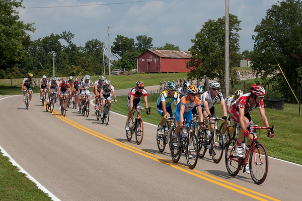 The peloton segments a bit as early break attempts are brought back.