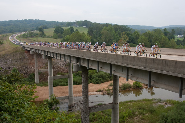 Here they lead the peloton across the Huzzah river.