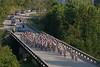 The peloton eases up as they cross the final bridge before Jefferson City...