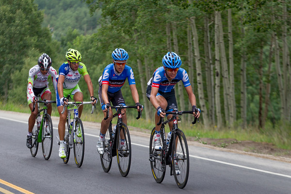 Near the last summit of the day, the foursome try to sustain their advantage - can they hold off the peloton?