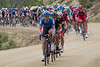 As the peloton hit the dirt, the attacks hit the peloton... most will be pulled back.