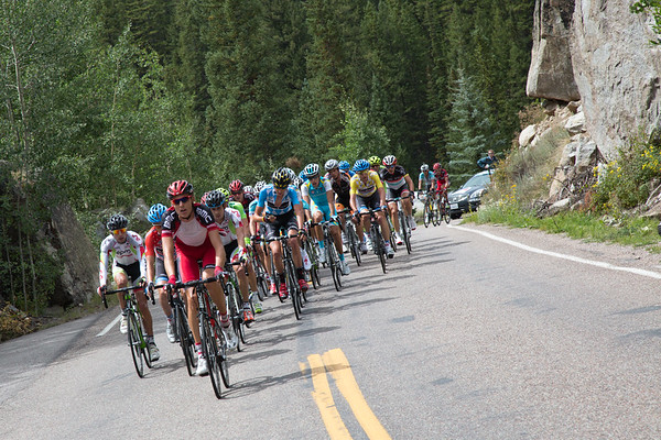 Behind, the peloton rides a steady tempo, there are a lot of miles ahead...
