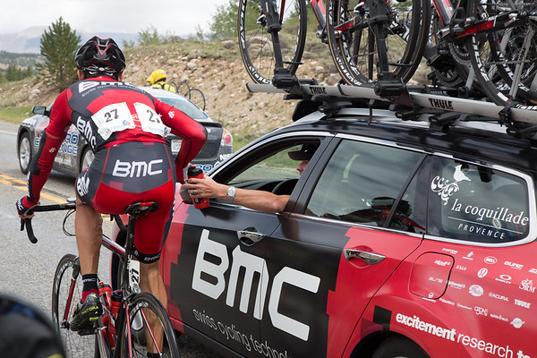 As the peloton nears Twin Lakes, Hincapie is back at his team car - discussing how to handle the break, and get Tejay back in yellow.