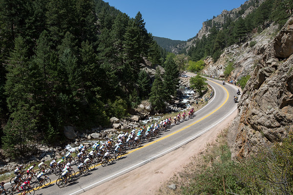 The BMC led peloton comes through the canyon about five and a half minutes later.