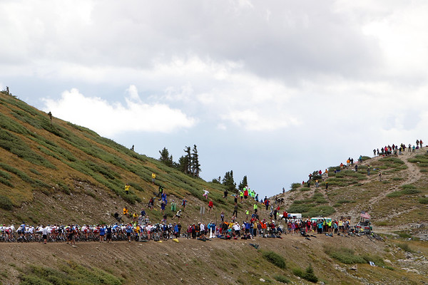 They are still together as they reach the crowds at the top of the pass.