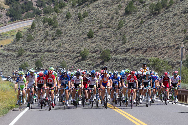 After the descent, the magic combination has gone up the road - the peloton finally relaxes.