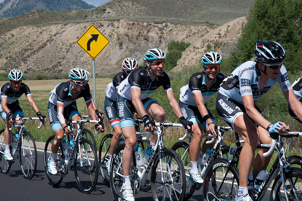 Back in the peloton, the other Leopard Trek riders are enjoying the ride, Voigt and Mortensen share a laugh.