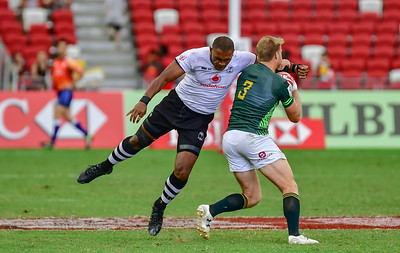 Isake Katonibau (Fiji) hits Dyland Sage (South Africa) with a high tackle,  a red card offense.