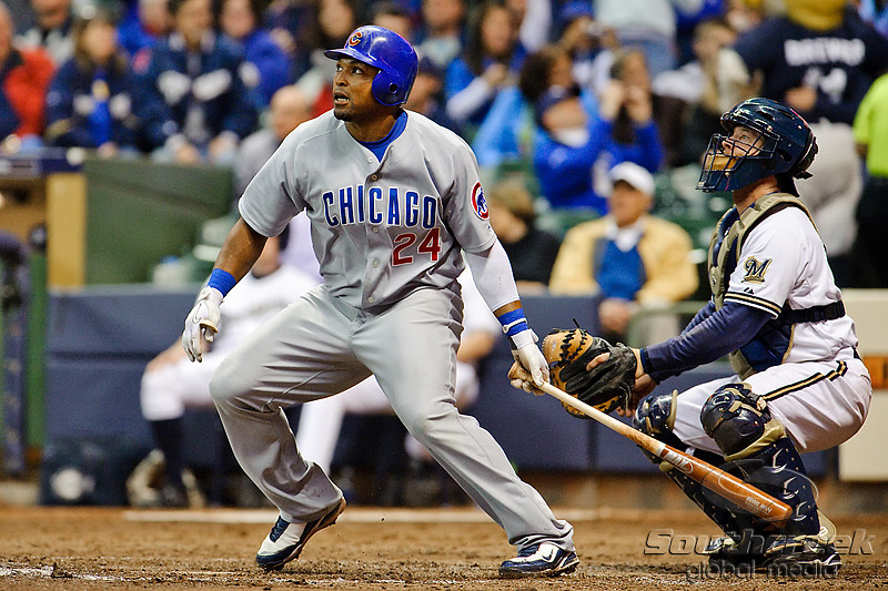 23 April 2010:  Chicago Cubs center fielder Marlon Byrd (24) hits a single during the game between the Milwaukee Brewers and Chicago Cubs at Miller Park in Milwaukee, Wisconsin.  The Cubs defeated the Brewers 8-1.  Mandatory Credit: John Rowland / Southcreek Global