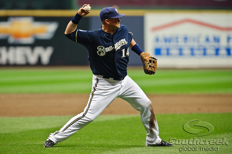 06 April 2010:  Milwaukee Brewers third baseman Casey McGehee (14) makes a throw to first during the game between the Colorado Rockies and Milwaukee Brewers at Miller Park in Milwaukee.  The Brewers won 7-5.<br /> Mandatory Credit: John Rowland / Southcreek Global