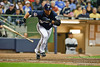 06 April 2010:  Milwaukee Brewers center fielder Carlos Gomez (27) lays down a bunt during the game between the Colorado Rockies and Milwaukee Brewers at Miller Park in Milwaukee.  The Brewers won 7-5.<br /> Mandatory Credit: John Rowland / Southcreek Global