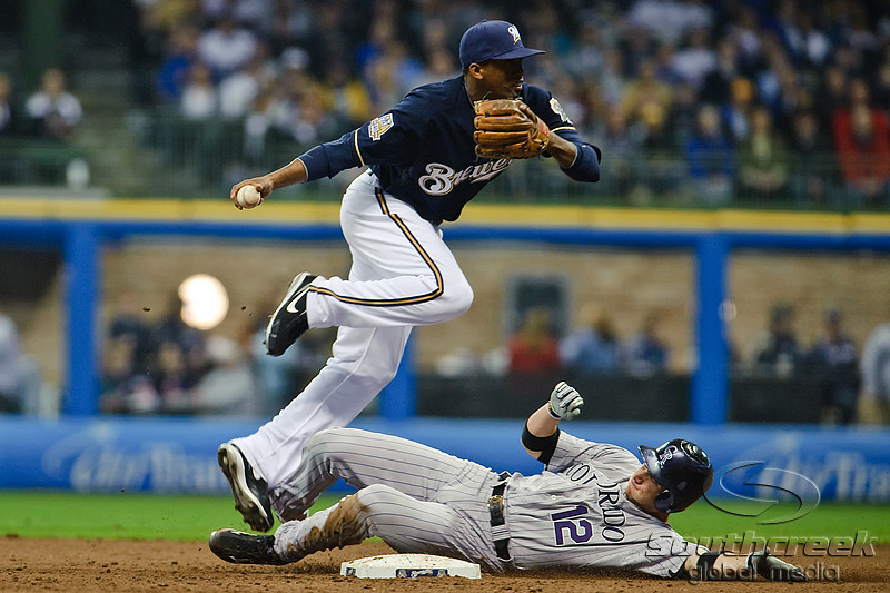 06 April 2010:  Colorado Rockies second baseman Clint Barmes (12) breaks up a double play attempt during the game between the Colorado Rockies and Milwaukee Brewers at Miller Park in Milwaukee.  The Brewers won 7-5.<br /> Mandatory Credit: John Rowland / Southcreek Global