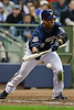 06 April 2010:  Milwaukee Brewers center fielder Carlos Gomez (27) lays down a bunt during the game between the Colorado Rockies and Milwaukee Brewers at Miller Park in Milwaukee.  The Brewers defeated the Rockies 7-5.  Mandatory Credit: John Rowland / Southcreek Global