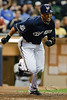 06 April 2010:  Milwaukee Brewers center fielder Carlos Gomez (27) runs to first after bunting during the game between the Colorado Rockies and Milwaukee Brewers at Miller Park in Milwaukee.  The Brewers won 7-5.<br /> Mandatory Credit: John Rowland / Southcreek Global