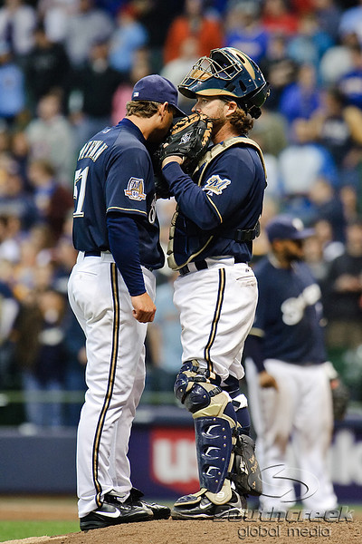 06 April 2010:  Milwaukee Brewers catcher Gregg Zaun (9) discusses strategy with Milwaukee Brewers relief pitcher Trevor Hoffman (51) during the game between the Colorado Rockies and Milwaukee Brewers at Miller Park in Milwaukee.  The Brewers won 7-5.<br /> Mandatory Credit: John Rowland / Southcreek Global