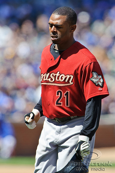 18 April 2010:  Houston Astros center fielder Michael Bourn (21) returns to the dugout during the game between the Houston Astros and Chicago Cubs at Wrigley Field in Chicago, Illinois.  Mandatory Credit: John Rowland / Southcreek Global