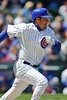 18 April 2010:  Chicago Cubs shortstop Ryan Theriot (2) runs to first trying to beat the throw during the game between the Houston Astros and Chicago Cubs at Wrigley Field in Chicago, Illinois.  Mandatory Credit: John Rowland / Southcreek Global